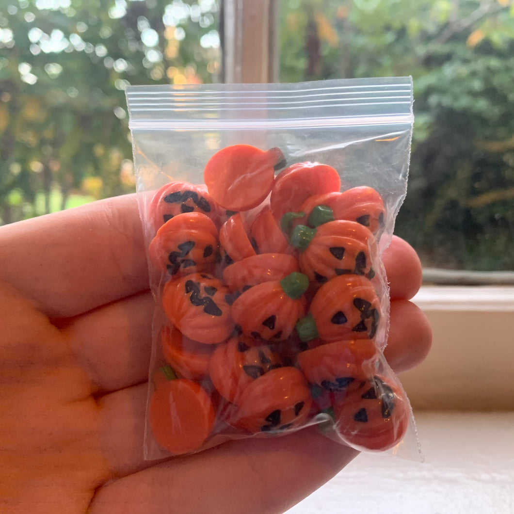 25 mini pumpkin charms.