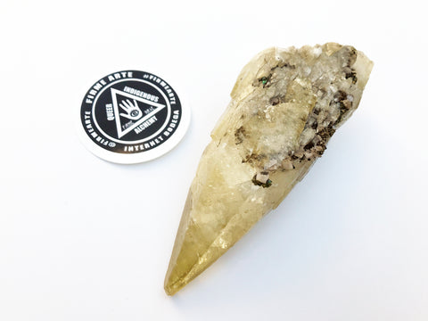 Crystals | Stellar Beam Golden Calcite Point w/ Pyrite