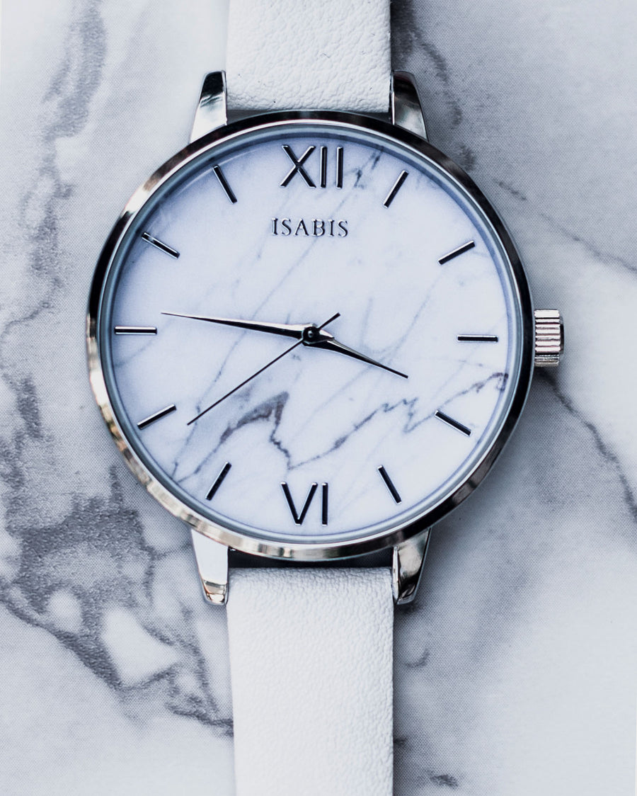 Quality womens fashion watch made with a vegan white leather strap and features a marble interface
