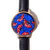 Quality womens fashion watch made with black vegan leather strap and red and blue ankara african fabric interface
