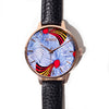 Quality womens fashion watch made with black vegan leather strap and red, blue, and yellow ankara african fabric interface