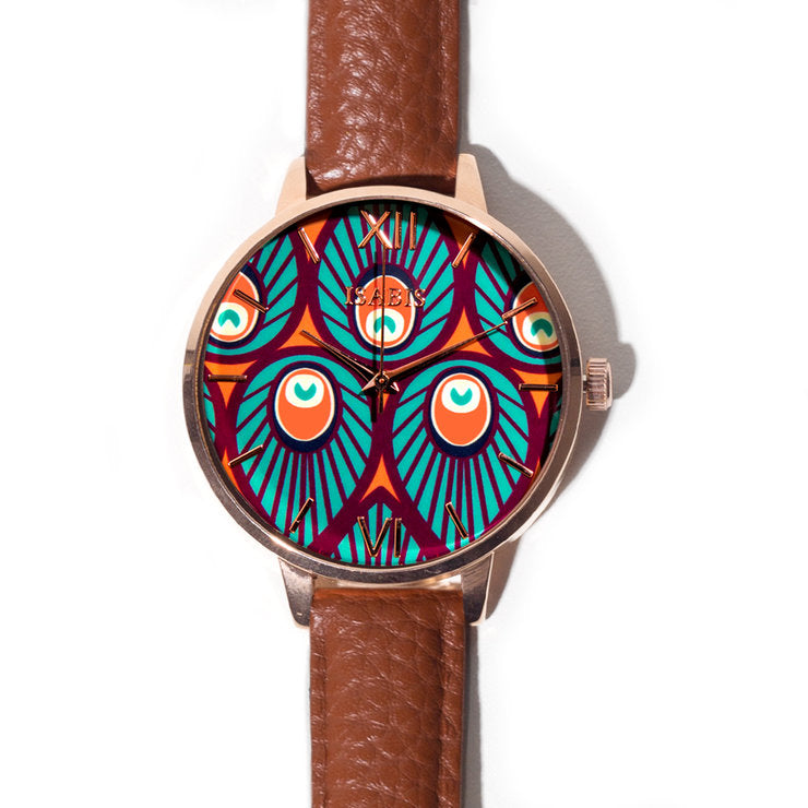 Quality Womens fashion watch made with a brown leather strap and multi colored ankara african fabric interface