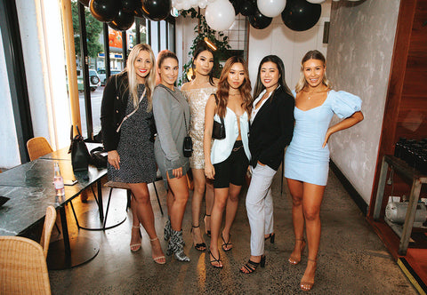 Calu Florencia, Petra Konyit, Alyssa Ho, Nicole Li, Cheryl Law, Ami Bilske in a group photo at the Slyletica event behind baloons at the Abacus Bar & Kitchen