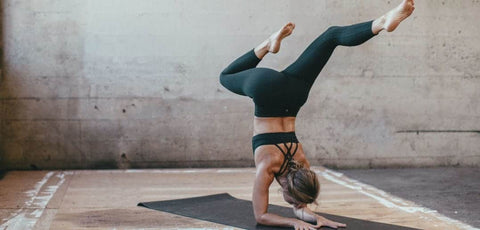Women in sports bra and legging athleisure doing Yoga for Luluelemon Campaign