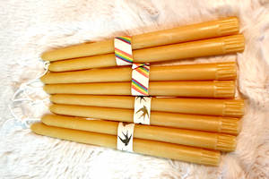 "4 pairs of 10"" taper candles bundled into pairs on a background of white fur"