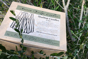A box of candles sits in a tree