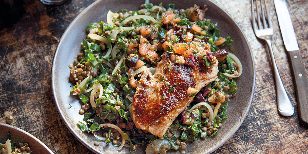 Lamb steak with rosemary, lentils & greens, & tomato, olive & caper dressing