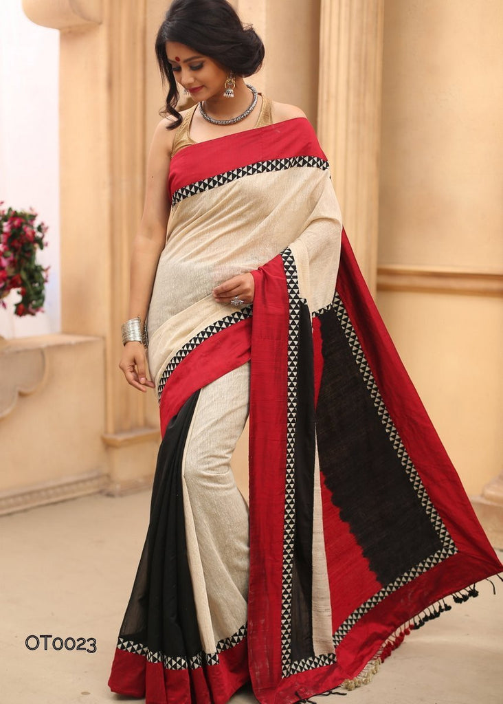 Beige cotton jute combined with elegantly designed hand dyed woolen pallu