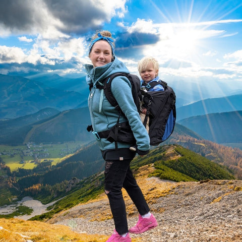 mum carrying toddler in adventure baby carrier