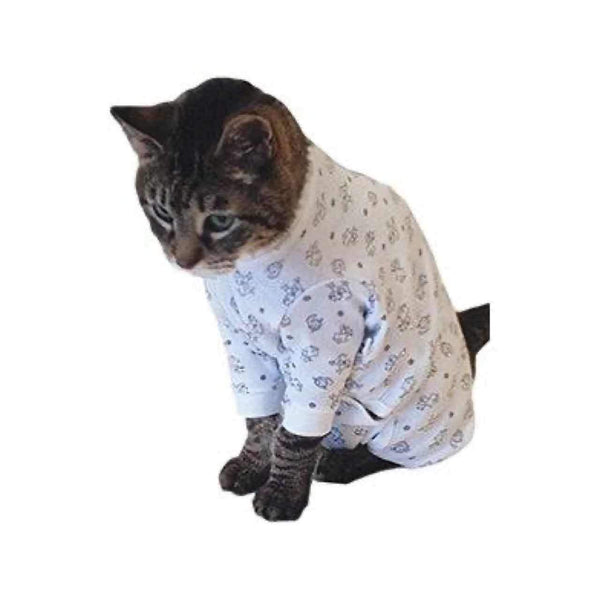A Tabby cat is wearing the Cover Me by Tui Cat Cone Alternative in kitty print