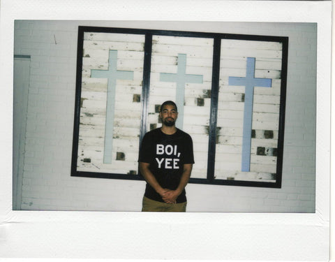 "Fletcher Williams III in the Charleston Sticks Together ""BOI, YEE"" tee."
