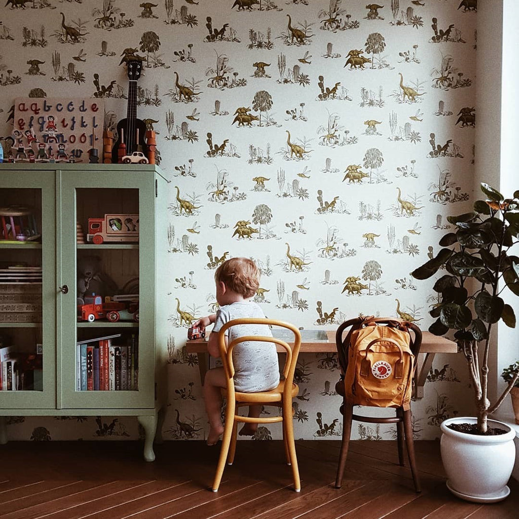A perfect place to play -- a wall-mounted desk against our Dino Wallpaper in Yellow Green courtesy of Karina Pelczar