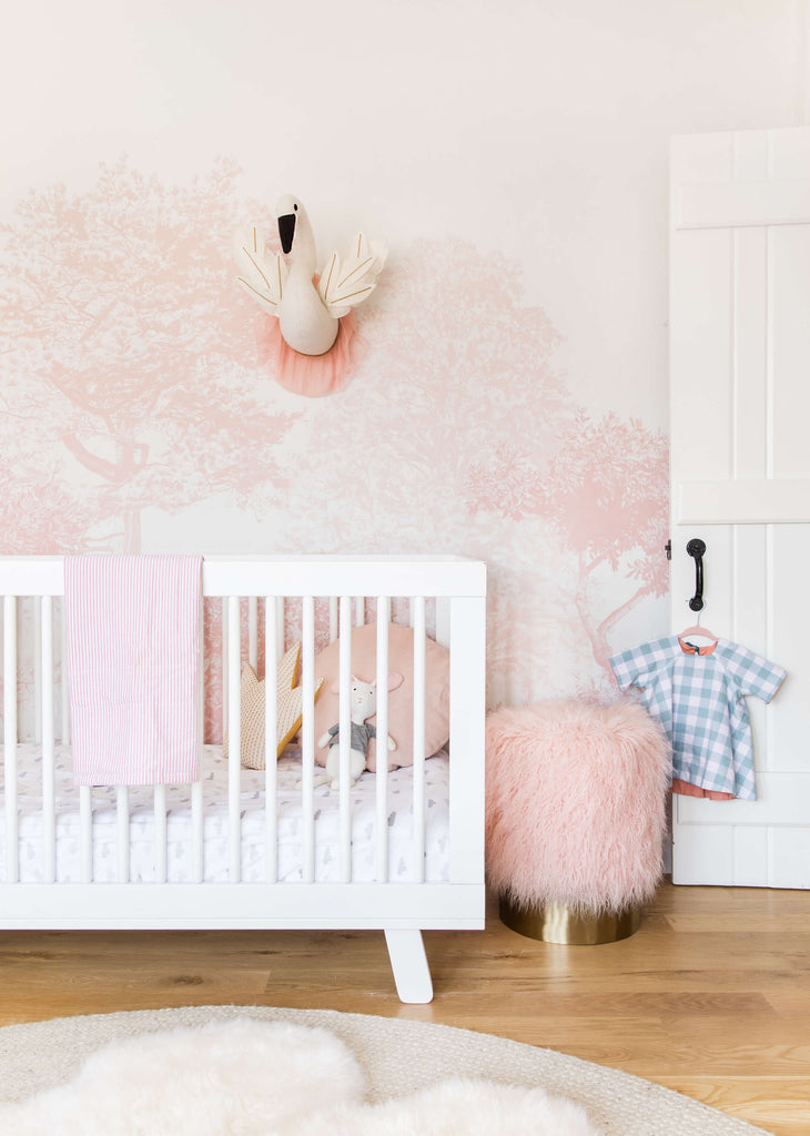 Dreamy pink nursery featuring Sian Zeng Hua Trees wallpaper in Pink / image by Emily Henderson