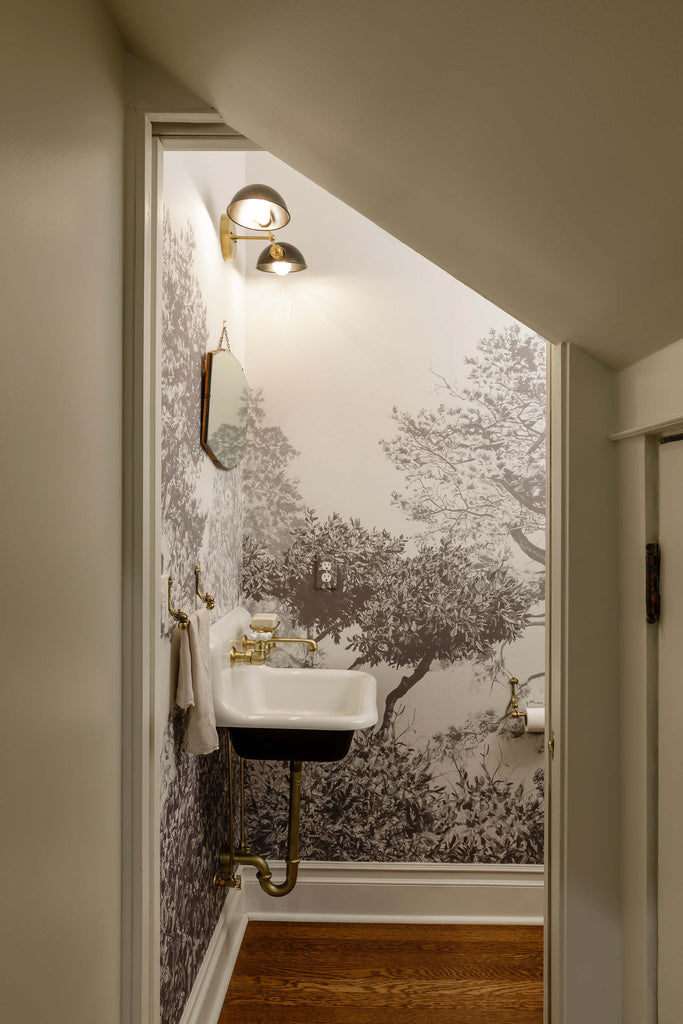 monochrome bathroom decorated with Hua Trees mural wallpaper in grey by Sian Zeng
