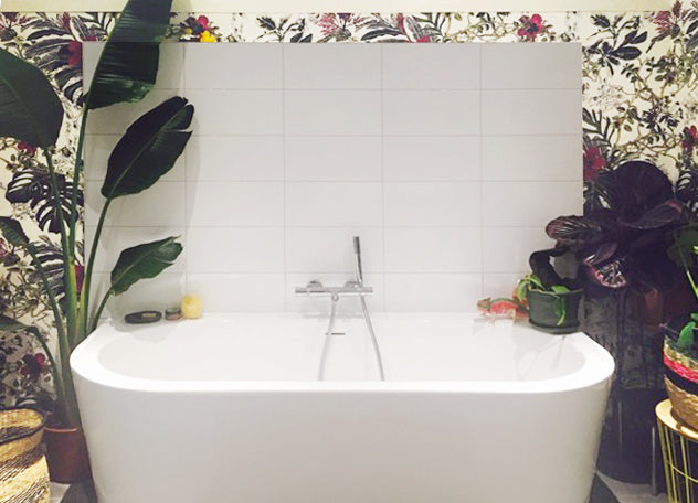modern white tiles and plants in the bathroom with Tropical Bloom wallpaper by Sian Zeng