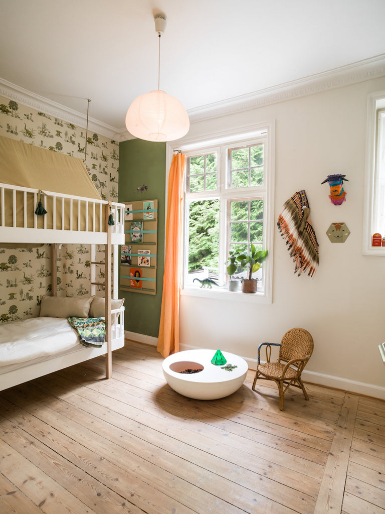 Dinosaurs roam in this kid's bedroom, with dinosaur wallpaper by Sian Zeng and bunk bed by Oliver Furniture / photo credit Lisbeth Kroll