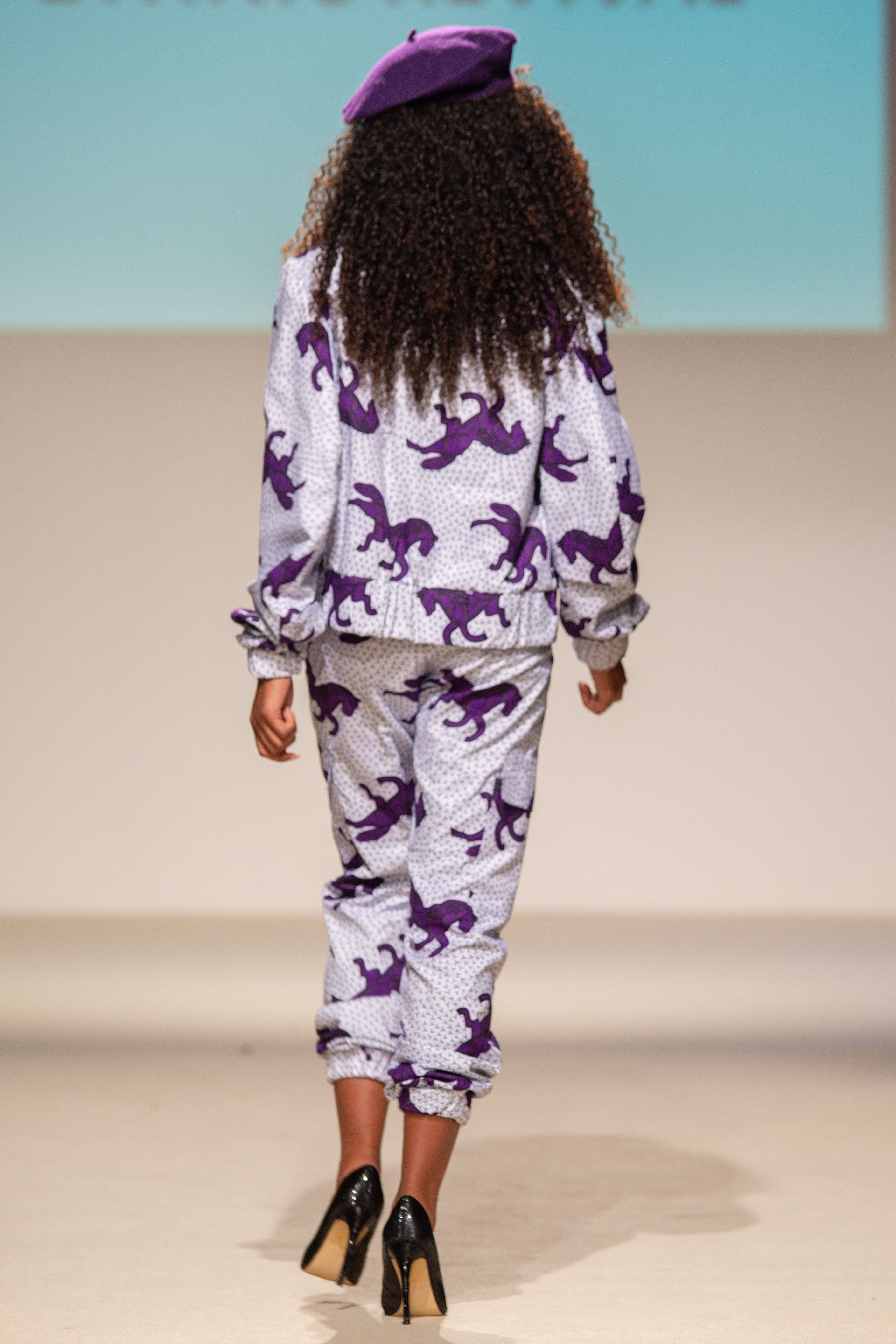 White and purple military track suit