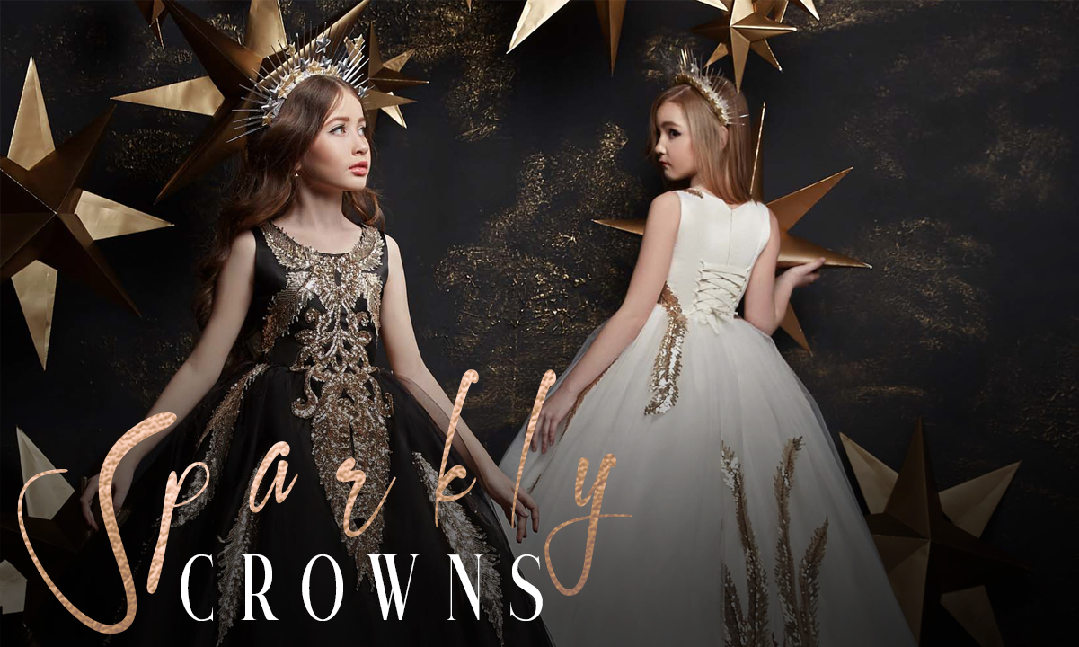 little girls model wearing black and white flower girl dresses with gold lace and crowns modeling for miele moda boutique