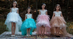 <alt>little girls wearing pretty colorful flower girl dresses from miele moda fashion house</alt>