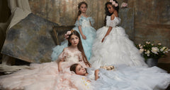 <alt>little girls wearing flower girls couture gowns handmade in Europe lace girl dress from miele moda boutique</alt>
