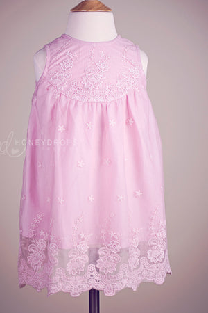 Pretty girl wearing Ada Button Down Toddler Lace Dress in Pink-by Miele Moda Boutique
