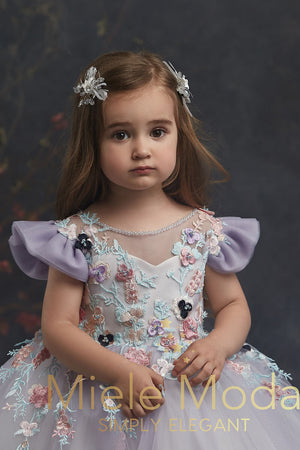 Pretty girl wearing Alexandrite Flower Girl Couture Dress-by Miele Moda Boutique