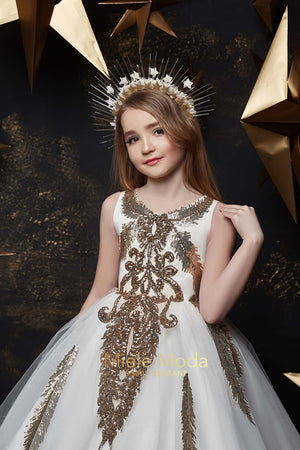 Pretty girl wearing Amara Couture Princess Dress-by Miele Moda Boutique