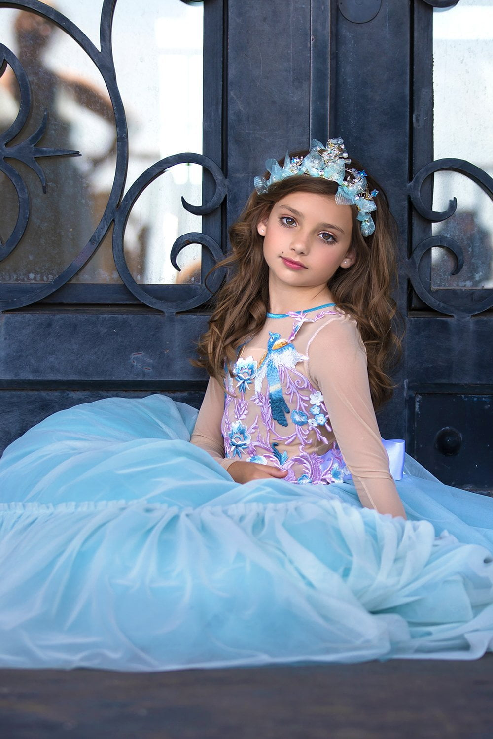 Pretty girl wearing Astra Crystal Stars Tiara with Soft Blue Bows-by Miele Moda Boutique