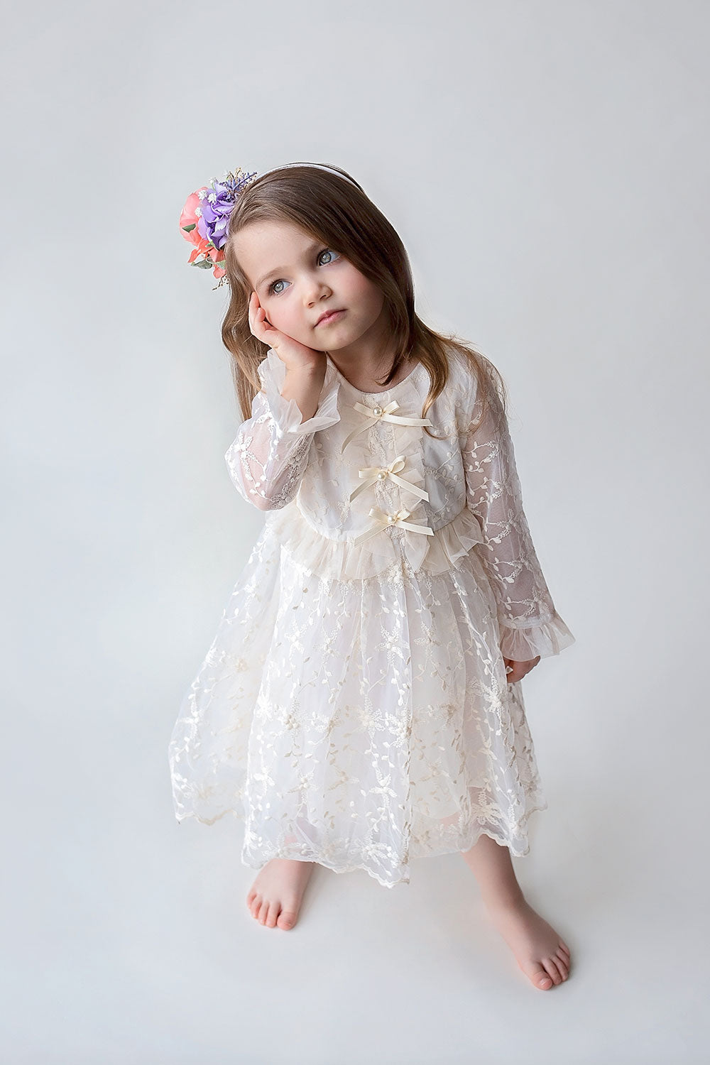 Pretty girl wearing Bianca Lace Girls Dress with Bows in Antique White-by Miele Moda Boutique