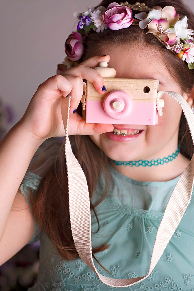 Pretty girl wearing Wooden Toy Camera For Toddlers Photo Prop-by Miele Moda Boutique