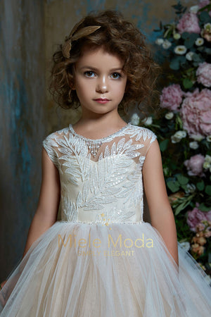 Pretty girl wearing Capri Flower Girl Couture Dress with Cape-by Miele Moda Boutique