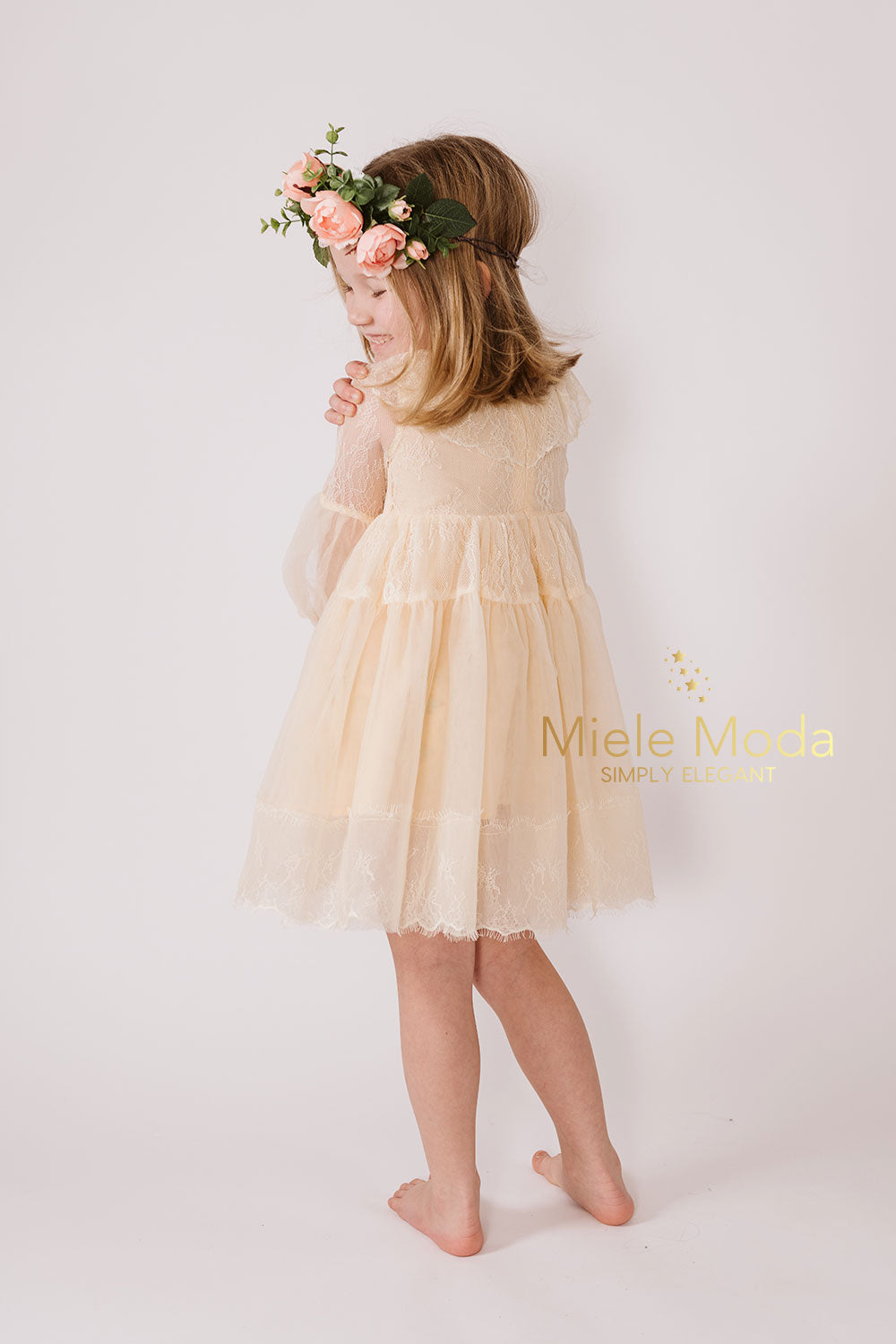 Pretty girl wearing Evelyn Long Sheer Sleeves Lace Dress in Melon-by Miele Moda Boutique