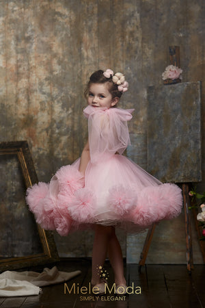 Pretty girl wearing Fancy Fab Doll Flower Girl Couture Dress-by Miele Moda Boutique