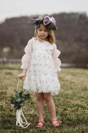 Pretty girl wearing Irene Lace Tule Floral Dress in White-by Miele Moda Boutique