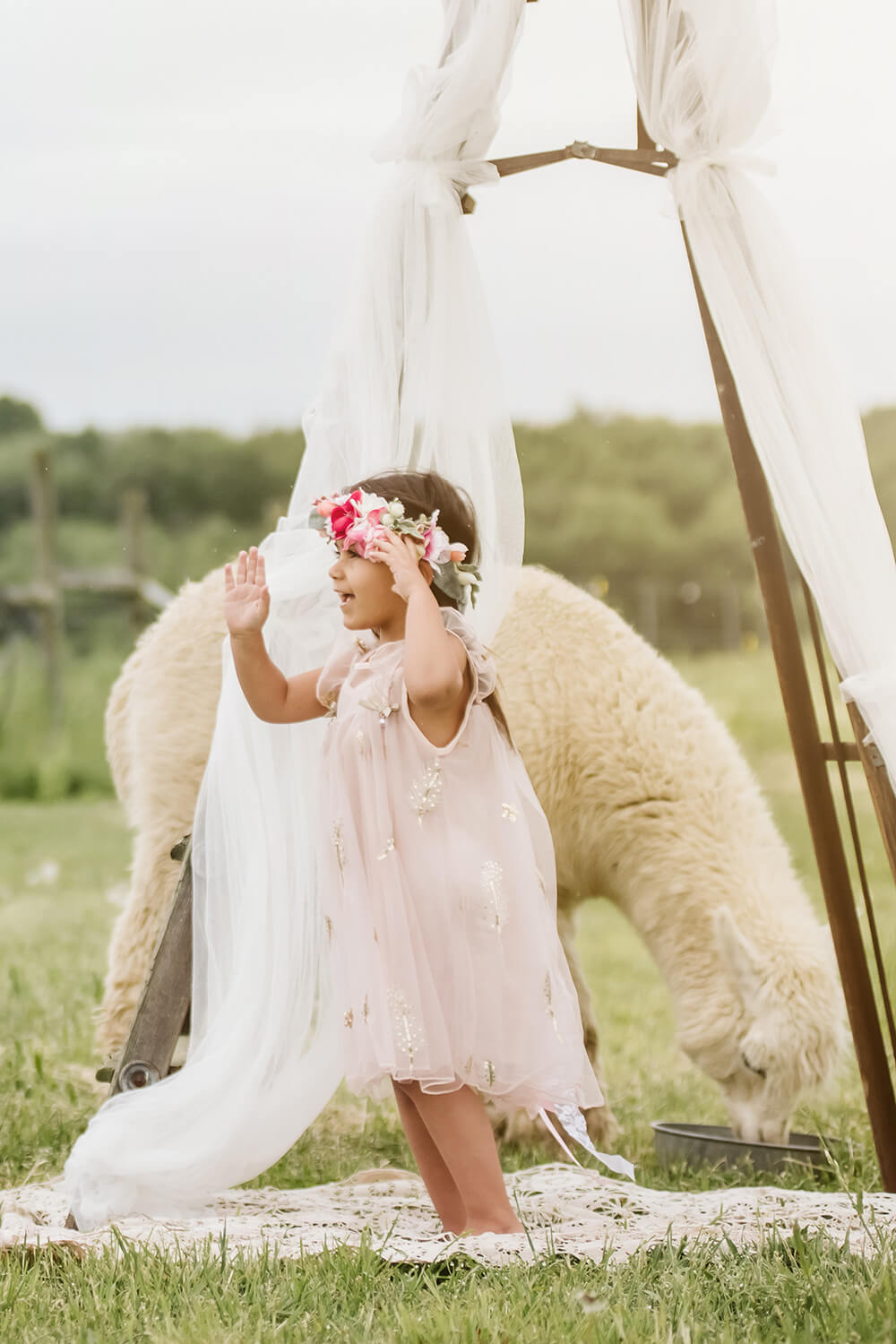 Pretty girl wearing June Sparkly Stars Feathers Girl Dress in Pink-by Miele Moda Boutique