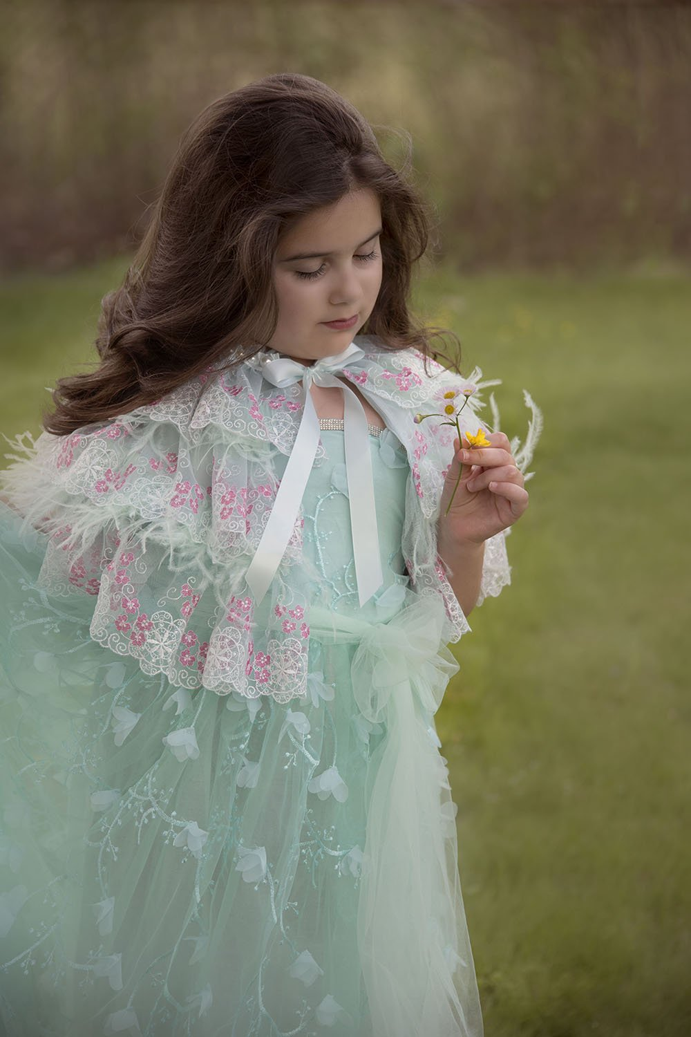 Pretty girl wearing Sabinna Deluxe Lace Feathers Mint Girl Fashion Cape-by Miele Moda Boutique