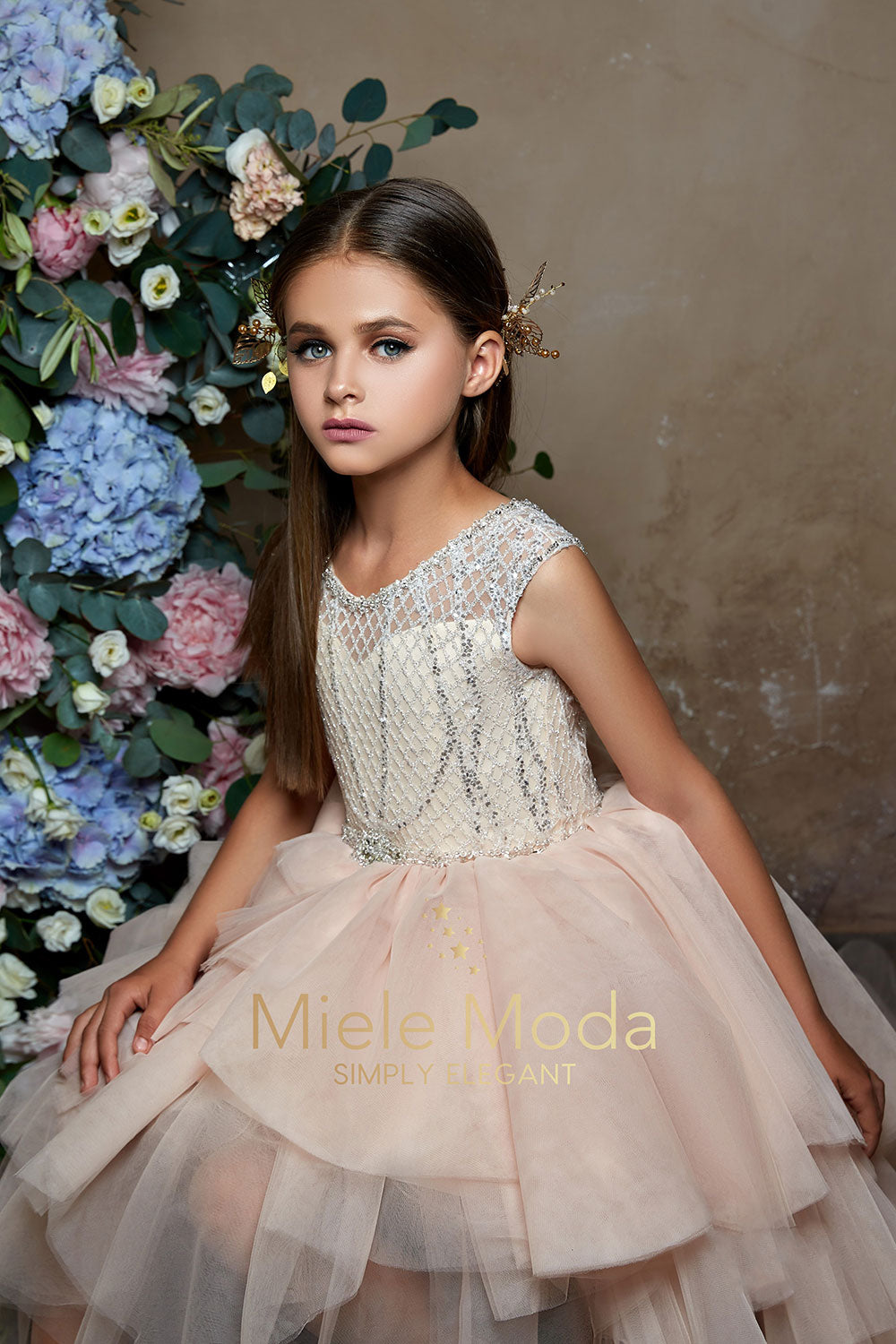Pretty girl wearing Macy Layered High Low Couture Dress-by Miele Moda Boutique