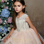 Pretty girl wearing Macy Layered High Low Dress-by Miele Moda Boutique
