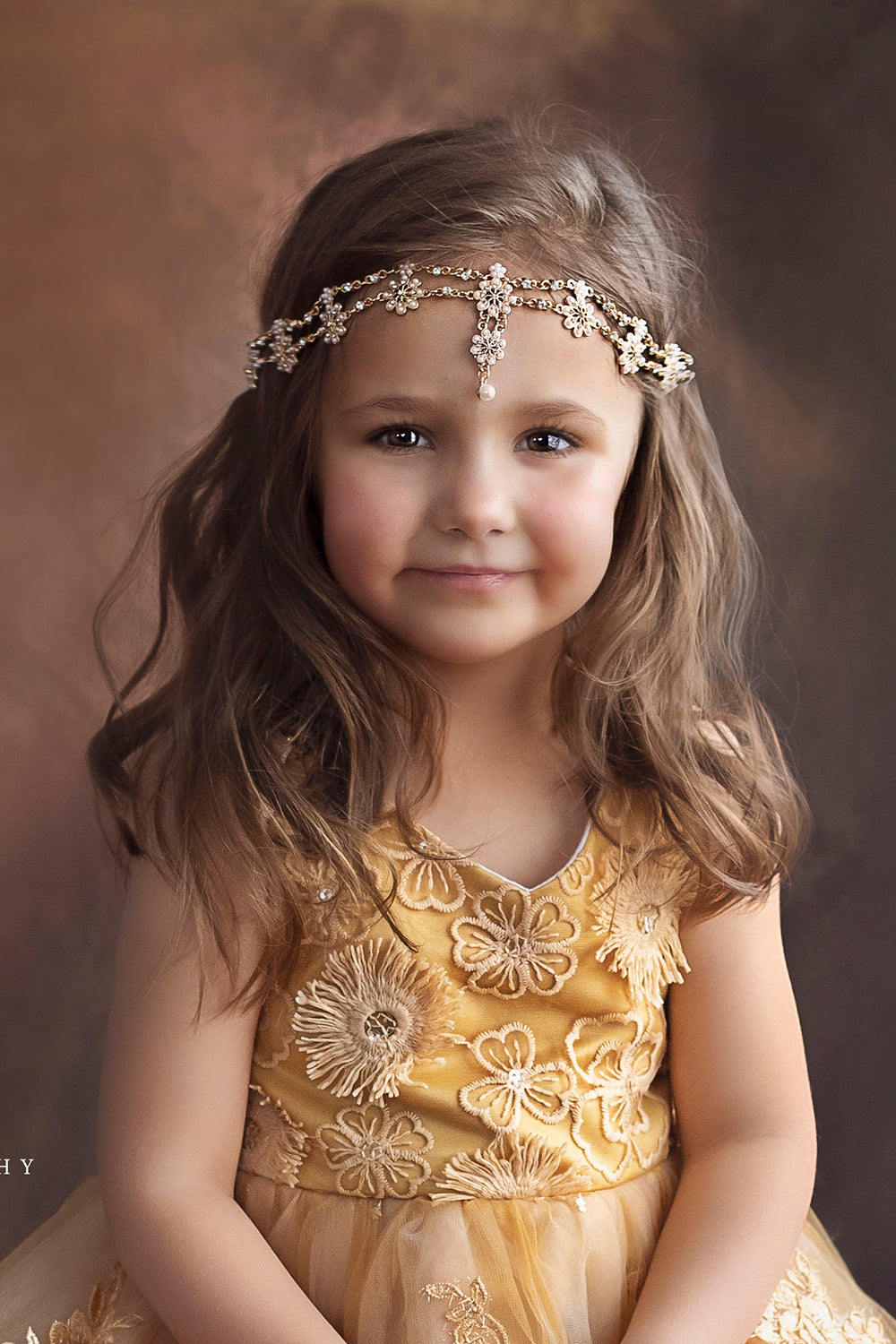 Pretty girl wearing Majesty Teardrop Gold Flowers Girl Headband-by Miele Moda Boutique