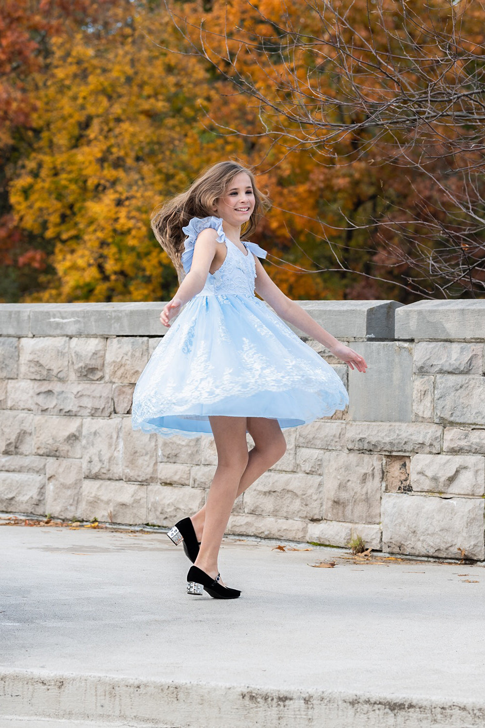 Pretty girl wearing Megan 3D Lace Sparkly Party Dress in Ice Blue-by Miele Moda Boutique