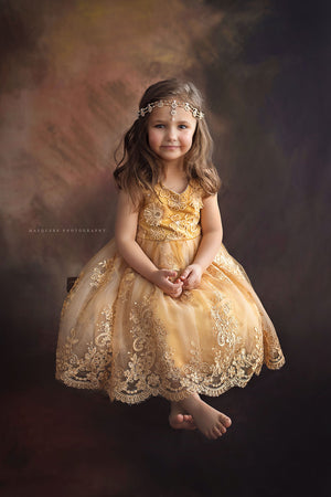 Pretty girl wearing Megan 3D Lace Sparkly Party Dress in Mustard Gold-by Miele Moda Boutique