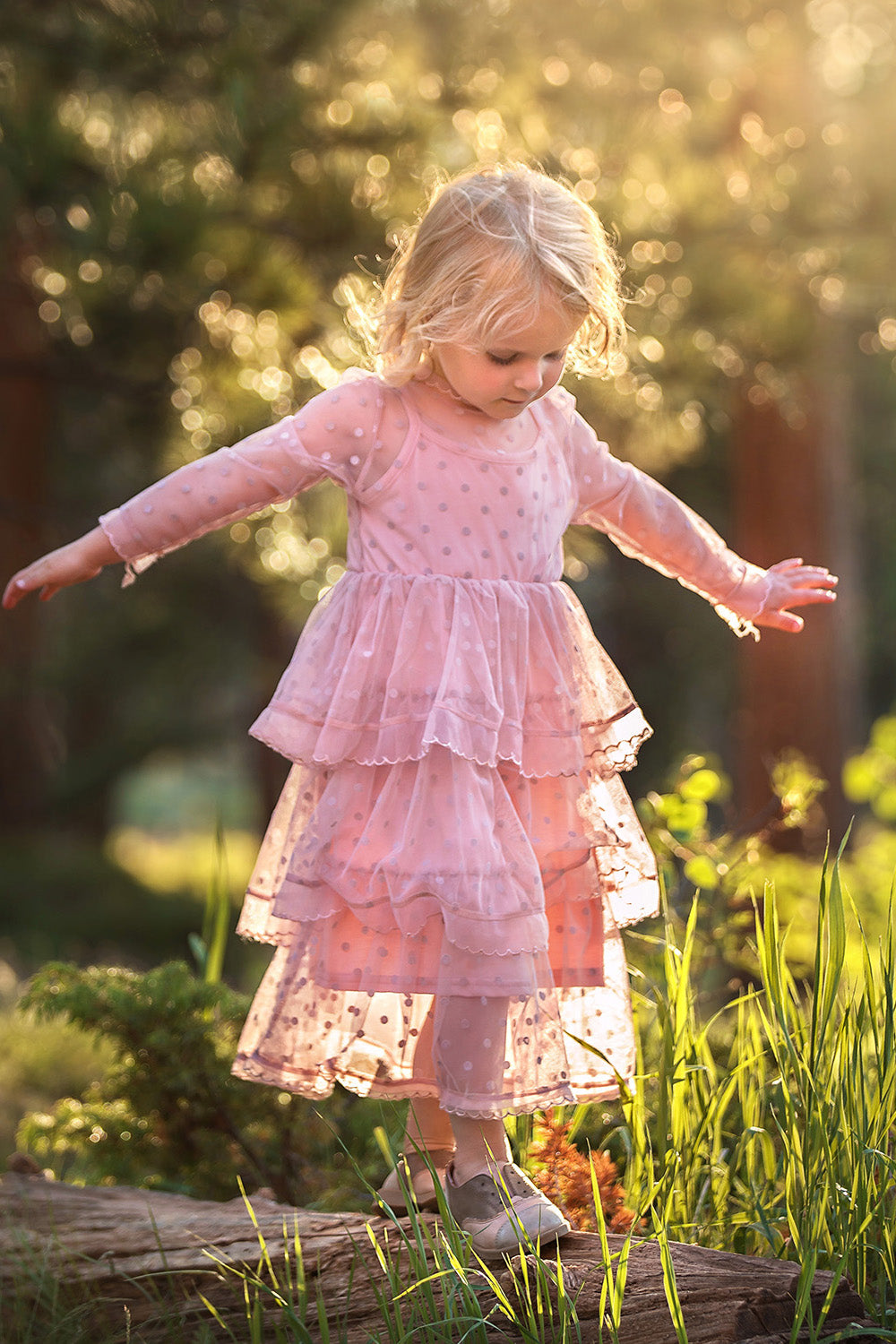 Pretty girl wearing Melanie Tulle Polka Dot Dress in Pink-by Miele Moda Boutique