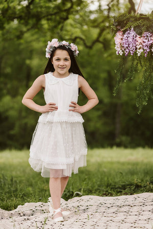 Pretty girl wearing Remina Girl Lace Dress with Stars in White-by Miele Moda Boutique