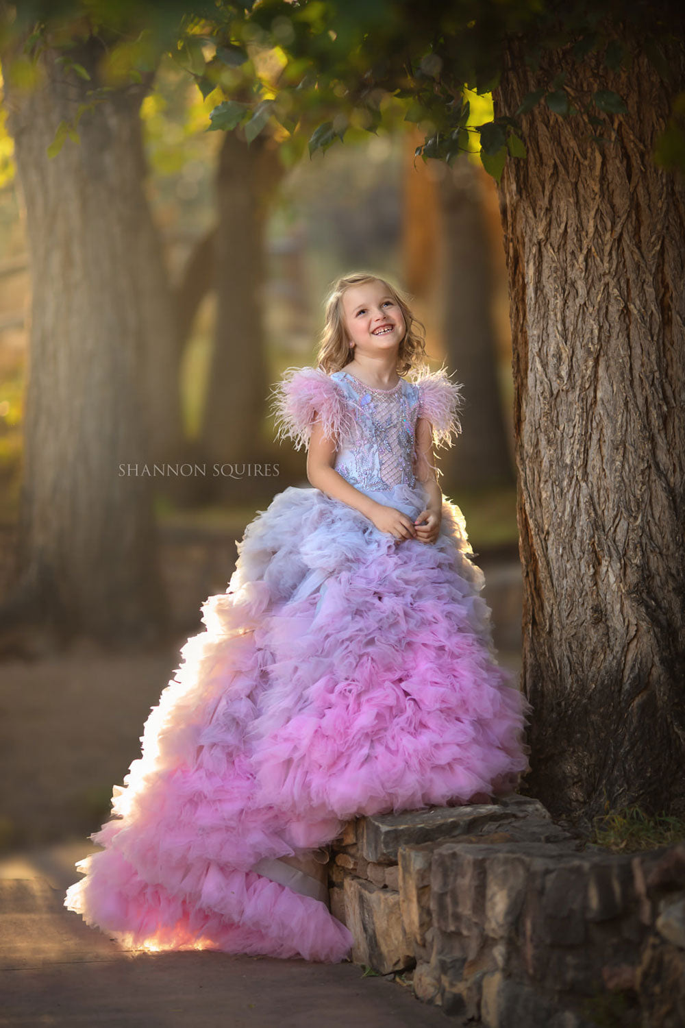 Pretty girl wearing Rosaline Flower Girl Couture Dress-by Miele Moda Boutique