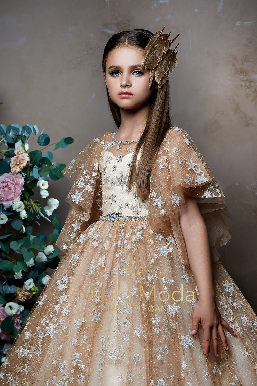 Pretty girl wearing Stellara Sparkly Stars Flower Girl Dress-by Miele Moda Boutique