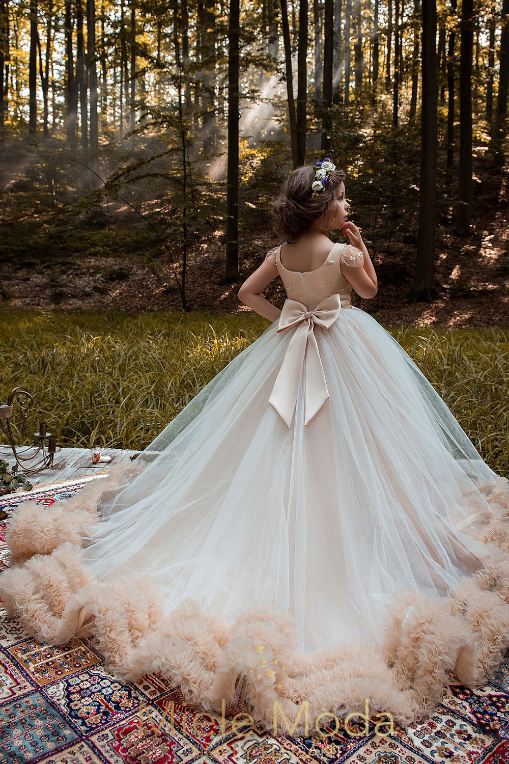 Pretty girl wearing special occasion ivory dress in the woods by Miele Moda Luxury Fashion