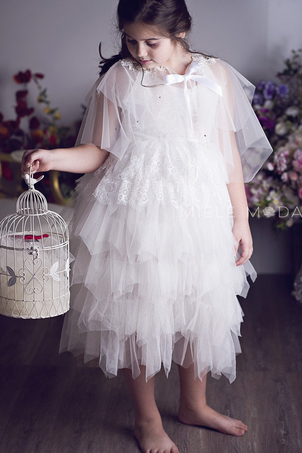 Pretty girl wearing Anna White Tulle Lace Girls Fashion Cape-by Miele Moda Boutique