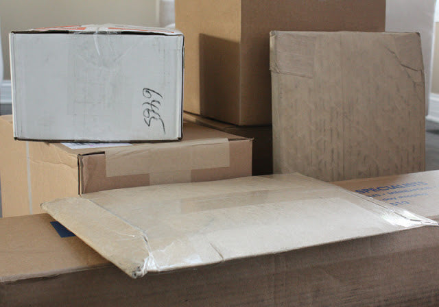 brown mail packages and boxes