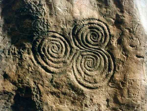 ic: Triple-spiral in passage at Newgrange.