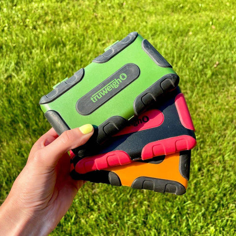 Truweigh TUFF weight scales in three colors green, red, and orange